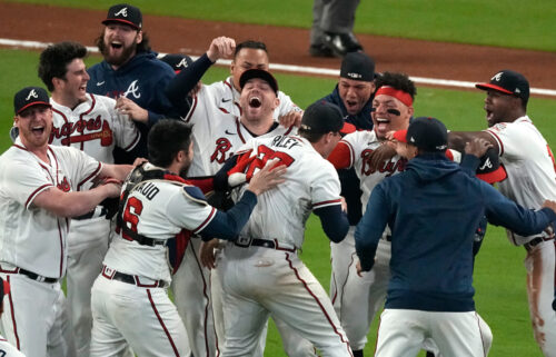 Atlanta Braves celebrate after winning Game 6 of baseball's National League Championship Series against the Los Angeles Dodgers Saturday