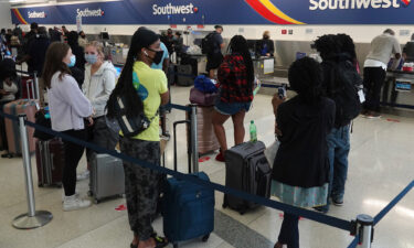 Passengers wait in line at the Southwest Airlines ticket counter at Fort Lauderdale Hollywood International Airport