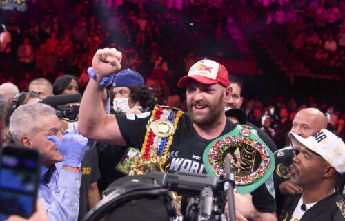 Tyson Fury wears his championship belts after defeating Wilder earlier this year.