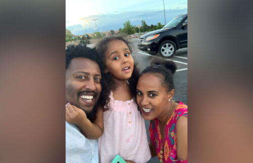 Dagne and Rahel Estifanos pose with their daughter