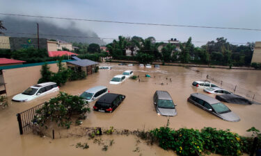 Submerged cars at a flooded hotel near the Jim Corbett National Park in Uttarakhand