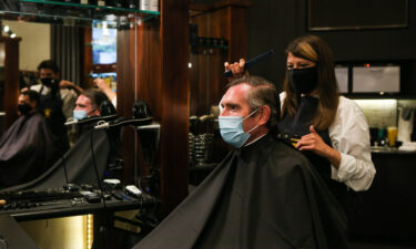 NSW Premier Dominic Perrottet receives a haircut on October 11