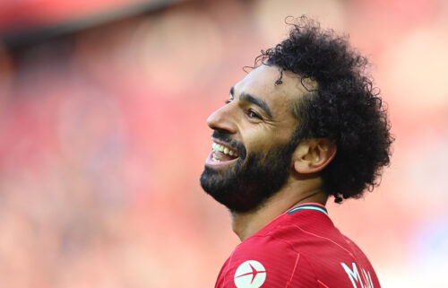 Mohamed Salah of Liverpool smiles during the Premier League match between Liverpool  and  Chelsea at Anfield on August 28