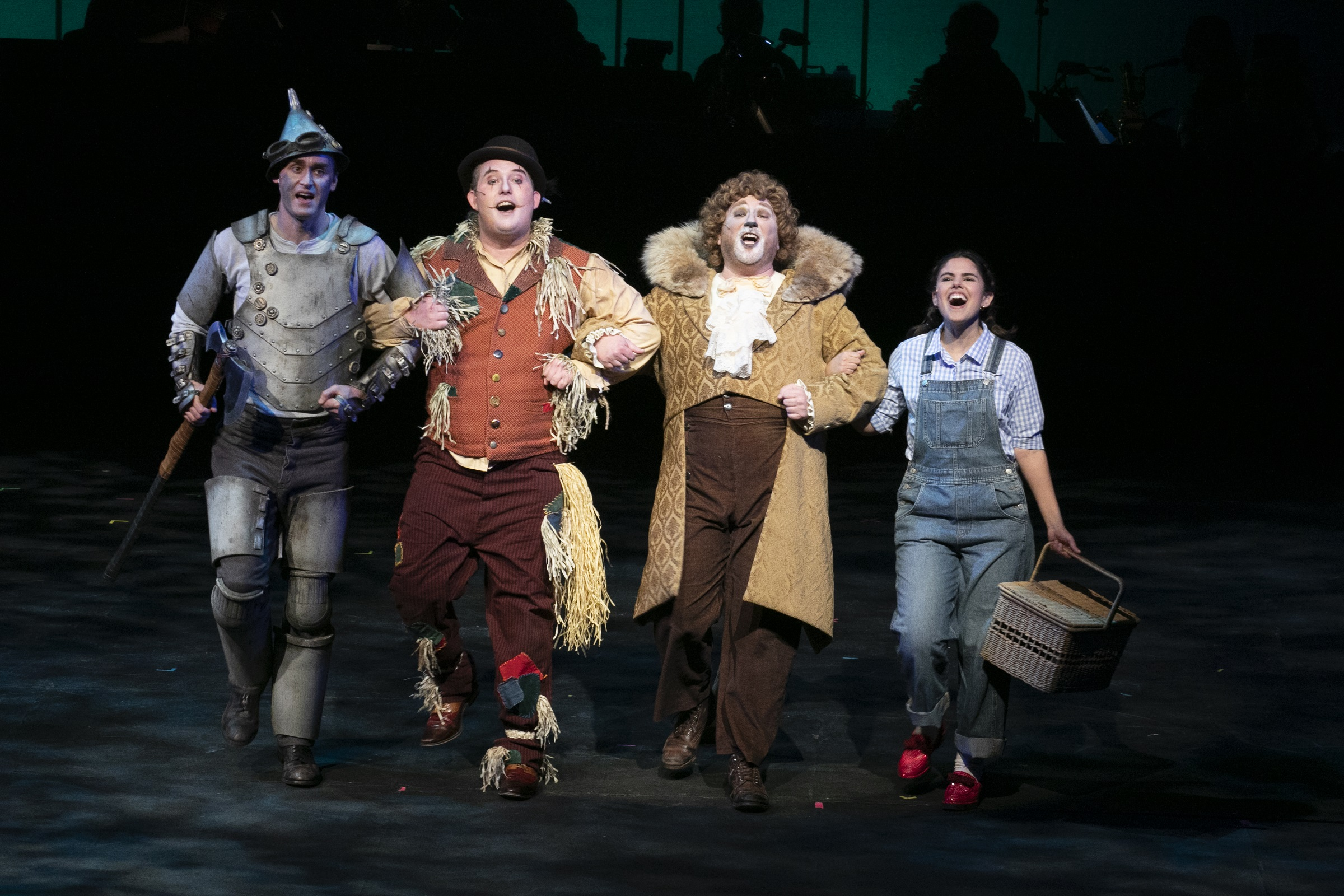Dorothy follows the Yellow Brick Road with the Tin Man (Eric Wishnie), the Scarecrow (Matthew Reich) and the Cowardly Lion (John Bridges).